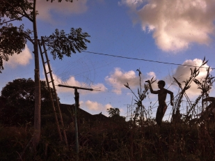 Félix Métayer-Mathieu performing Furikake, with water sprinkler, at Komang's farm in Mas. Cover for Stephen Black's book, 'Furikake: short stories about rice seasonings'